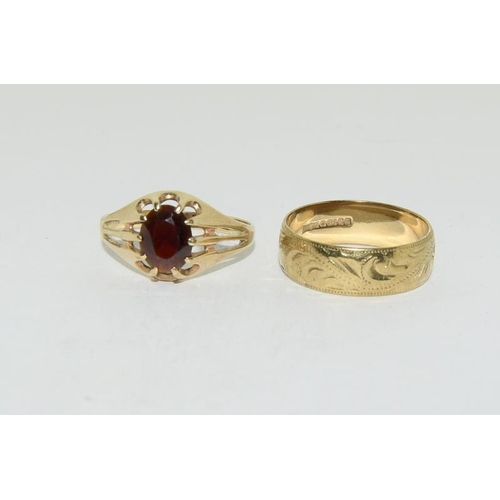 21 - 9ct gold man's garnet ring, size U, together with a 9ct gold wedding band....