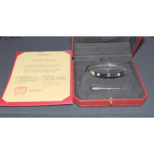 22 - Cartier 18ct gold diamond love bangle, boxed with screw adjuster and certificate....