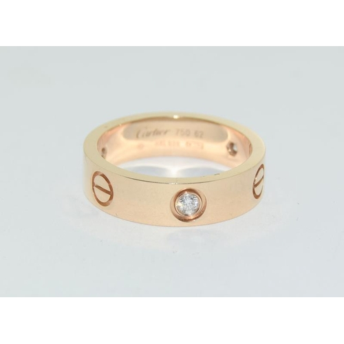 5 - Cartier 18ct gold love ring with diamond....