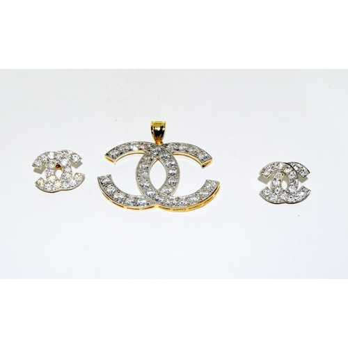 7 - Chanel style pendant and earrings 11K....