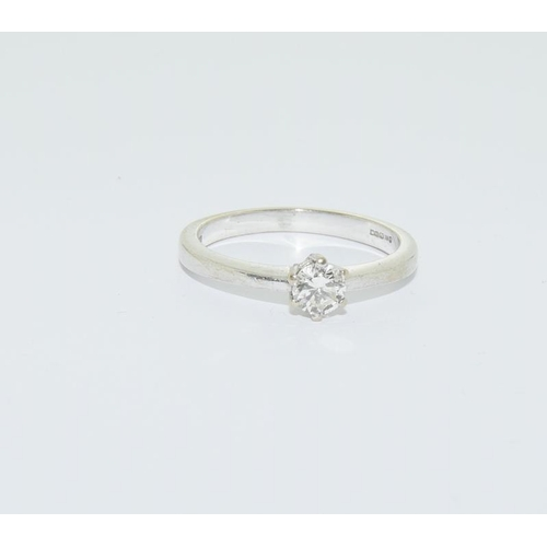 28 - 18ct white gold ladies diamond solitaire ring, 0.33ct, size Q....