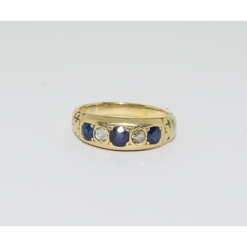 48 - Yellow metal ladies diamond and sapphire ring, size L....