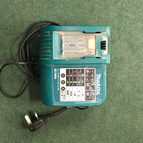 2005 - A Makita battery charger (REF:13)....