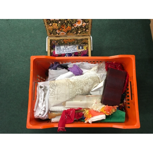 2022 - A crate of linen and sewing accessories....