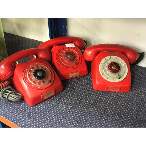 2031 - Three red telephones....