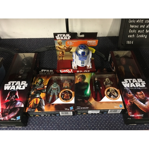 2035 - A Hasbro collection of Star Wars figures and an R2-D2 Bop It! (REF:37)....