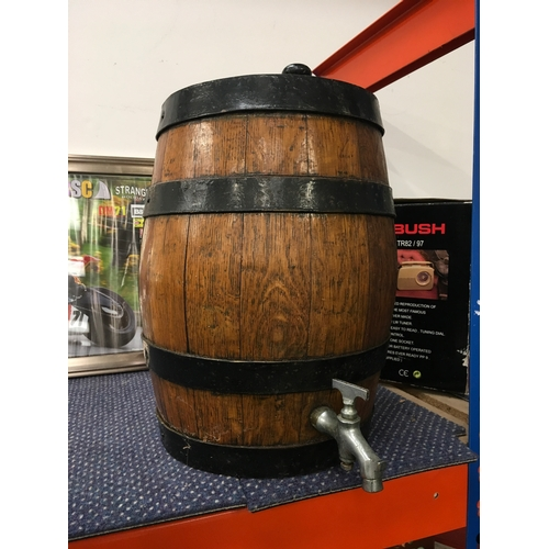2046 - A wooden barrel with tap....