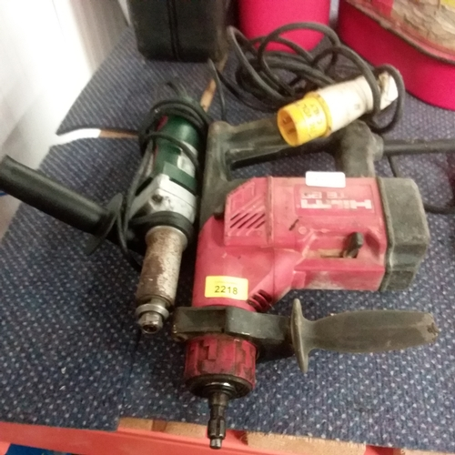 2100 - A Hilti TE 25 drill together with a Metabo power tool....