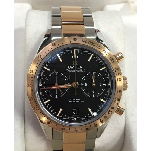 44 - Omega rose gold and stainless steel Speedmaster, co-axial movement....