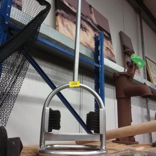 2126 - A pole boot scraper with brush (137)....