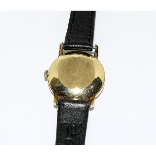 19 - Omega wristwatch - manual wind. 9ct gold....