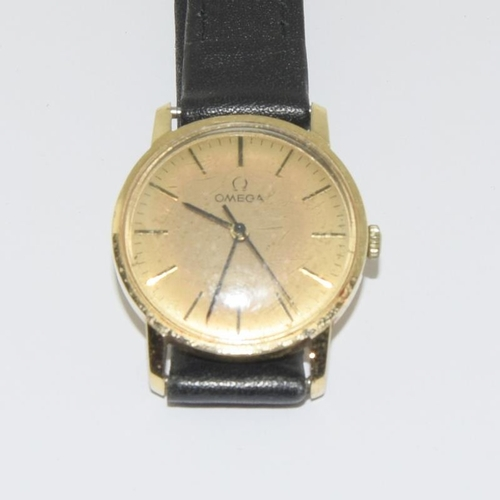 19 - Omega wristwatch - manual wind. 9ct gold....