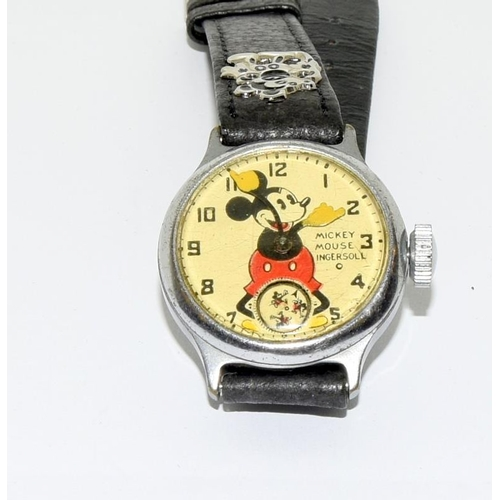 24 - 1933 Ingersol genuine Disney Mickey Mouse wristwatch -  working. Comes on a genuine Disney after mad...