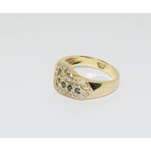 31 - 14ct gold diamond and sapphire buckle ring....