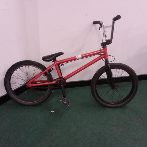 2243 - An Orange Pivotal BMX bike (REF 15)....