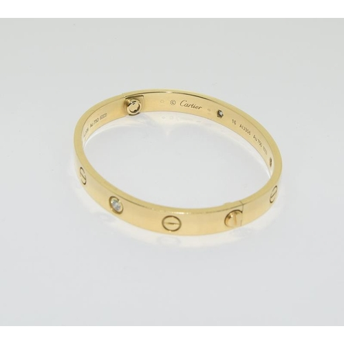 2156 - Cartier 18ct gold and diamond love bangle. Ref 76....