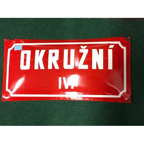 1020 - A red enamel house address sign....