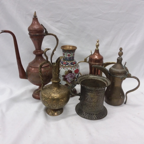 1004 - A collection of brass jugs together with a brass vase. Six in total....
