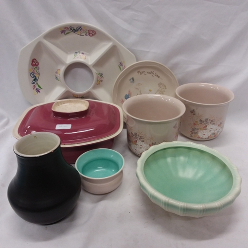 1022 - A collection of pottery to include Poole Pottery....