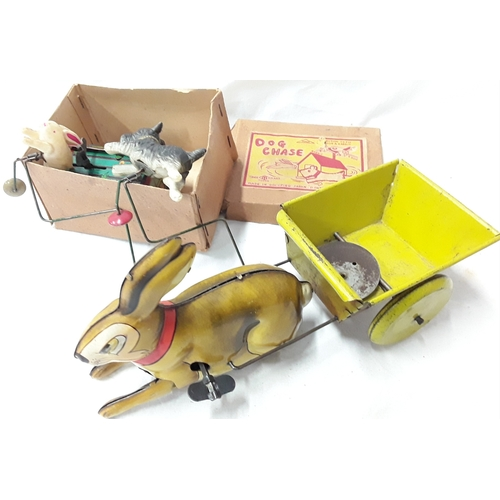 334 - Dog Chase (Japan) tinplate wind up toy in box together with British made tinplate Rabbit pulling a c...