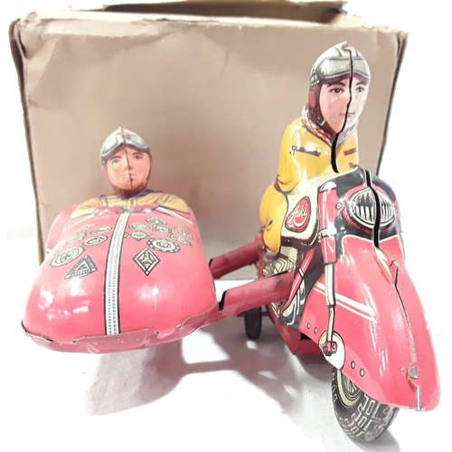 332 - Huki (W. Germany) Motorcycle and Sidecar, c.1950's: tinplate motorcycle in red with tinprinted detai...