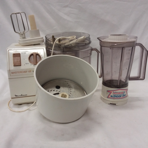 1027 - A Moulinex Masterchef 65 electronic mixer with various attachments....