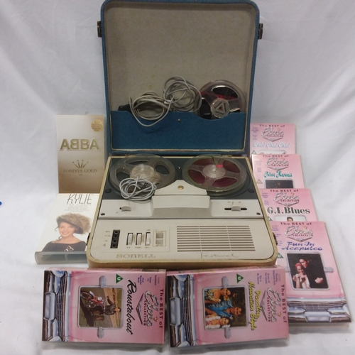 1033 - A vintage Sobell reel to reel tape recorder together with a collection of Elvis, ABBA and Kylie VHS ...