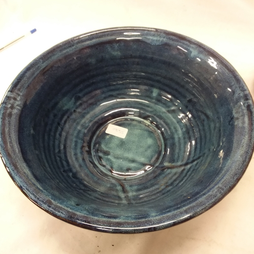 1039 - A large blue porcelain bowl with a smaller brown one....