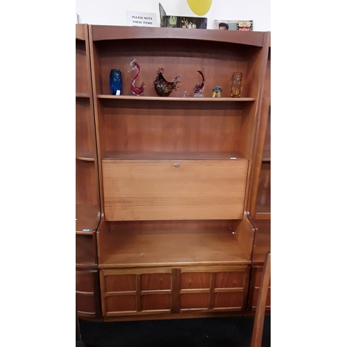 1405 - A teak 1970's Nathan wall unit with secretaire cupboard and two shelves to top with storage cupboard...