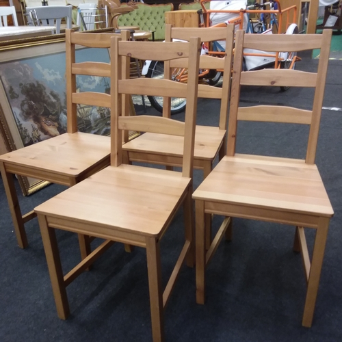 1425 - A set of four pine ladder back kitchen chairs....