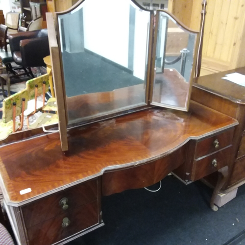 1429 - A flame mahogany dressing table of five drawers with a tri fold mirror to top all resting on cabriol...