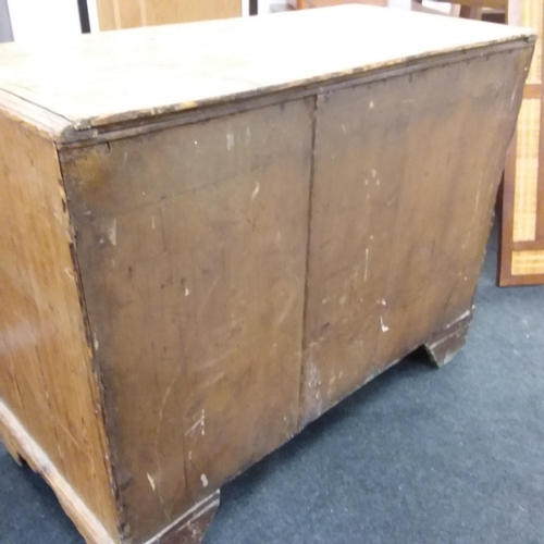 1436 - A pine chest of three long drawers resting on bracket feet....