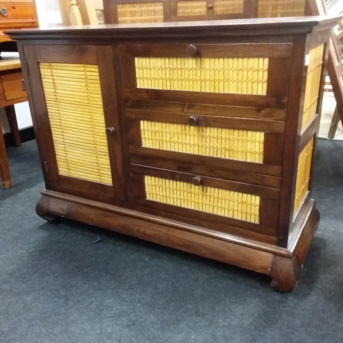 1437 - A hardwood and bamboo screened three drawer cabinet with a single cupboard.95x35x70cm....