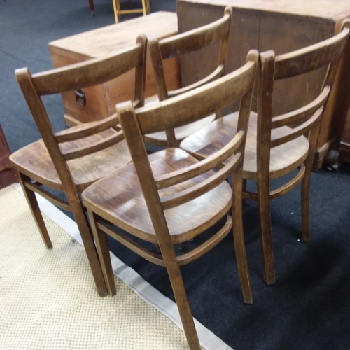 1446 - A set of four kitchen chairs....