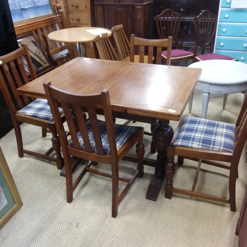 1448 - An oak drawleaf dining table with four dining chairs....