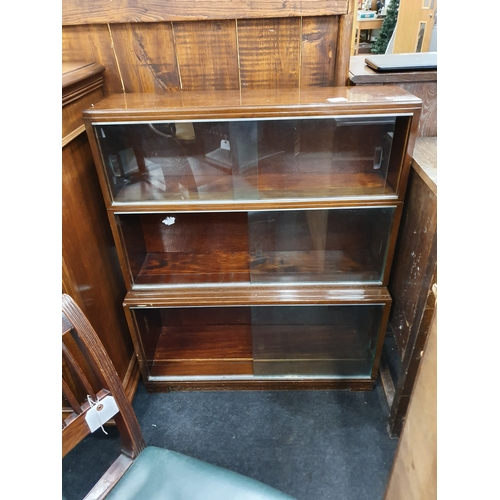 1453 - A vintage three section mahogany glazed fronted bookcase....