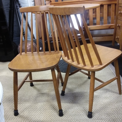 1457 - A pair of stick back dining chairs....