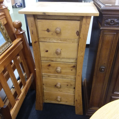 1462 - A five drawer shaped narrow pine chest....
