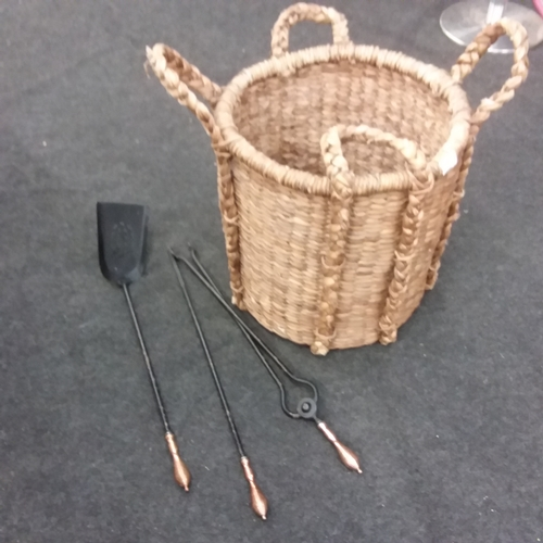 1466 - A reed log basket with fire irons....