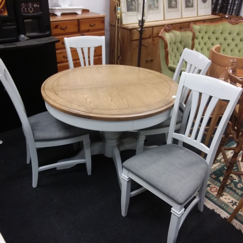 1470 - A modern circular dining table with four dining chairs....