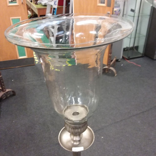 1480 - A cast aluminium candle stand with large inverted glass bell....