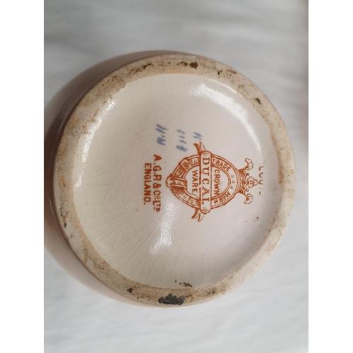 2044 - Three Crown Devon floral patterned porcelain vases....