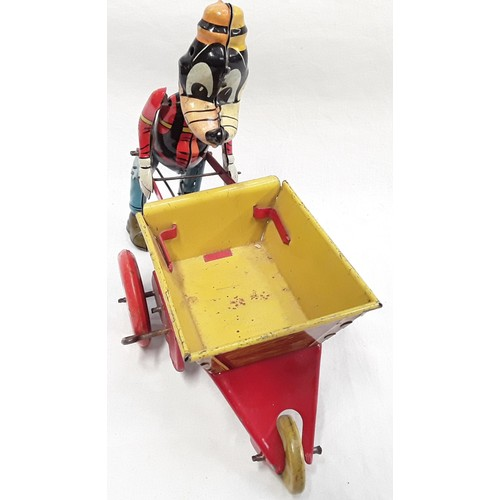 364 - Marx (UK) Goofy the Gardener. 1950's. Colourful clockwork tinplate toy with walking action when whee...