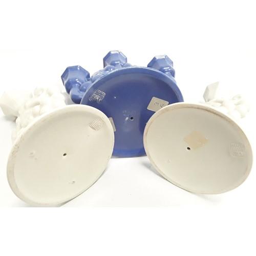 121 - Poole Pottery Carter Stabler Adams pair of John Adams single branch shape 963 candelabra in white, t...