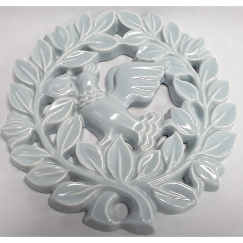 122 - Poole Pottery shape 312 pierced wall plaque of a dove within garlands of leaves in pastel blue glaze...