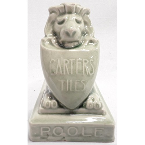 26 - Carters & Co Poole Pottery Lustre advertising lion desk paperweight....