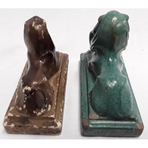 25 - Carters & Co Poole Pottery advertising lion desk paperweight, plus one other....
