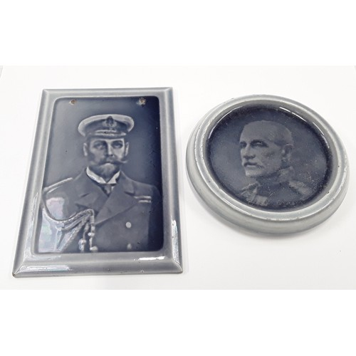 34 - Poole Pottery George V portrait tile/plaque (drilled), together with a circular plaque of Field Mars...