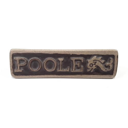 104 - Poole Pottery stoneware small advertising sign 2.8