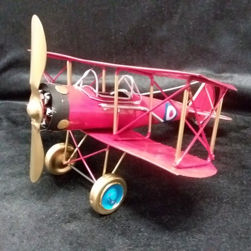 1040 - A tin plate Bi-Plane.(170)....